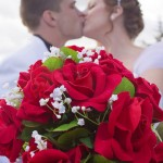 bride-groom-kiss-flower-bouquet