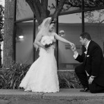 groom-kneeling-outside